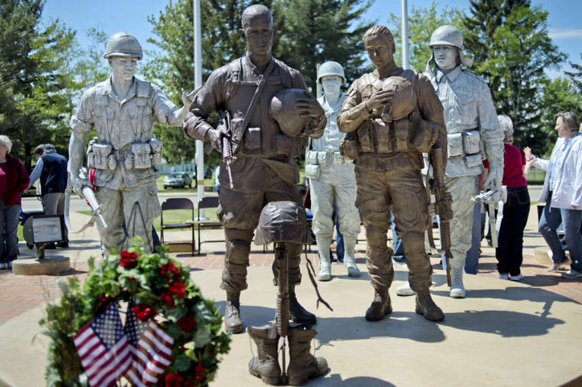NICK KING | nking@mdn.net The Coleman Veterans Memorial statues after a Memorial Day and dedication ceremony on Monday. The female solider was officially unveiled.