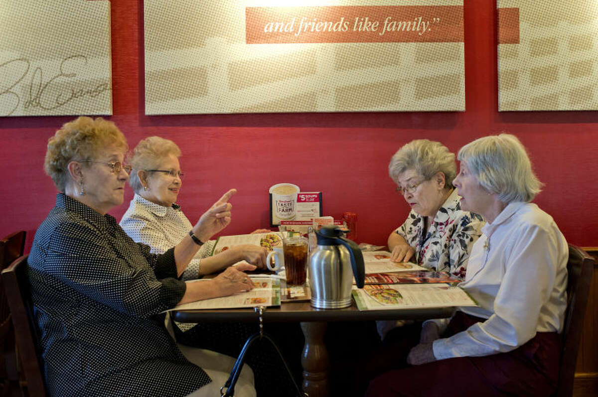 NICK KING   nking@mdn.net From left, Lois Lunsford, Margaret Johnston, Joan Fulkerson and Nancy Dent figure out what to order during their lunch at Bob Evans on Tuesday in Midland. The four women, were friends while in school at Carpenter Elementary and then Midland High, have been dining together once a month for years.