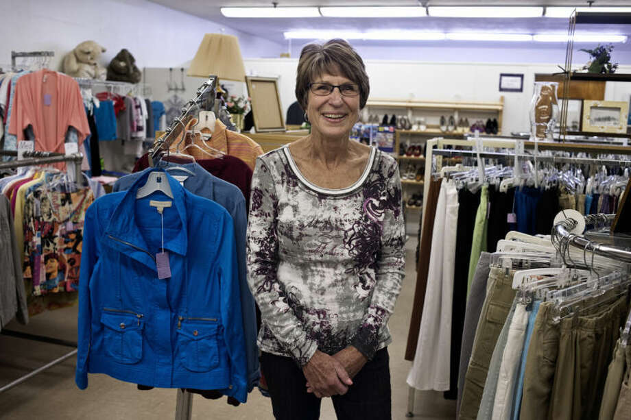 SEAN PROCTOR | sproctor@mdn.netLinda Hutchison, of Midland, poses for a portrait in the King's Daughters and Sons Thrift Shop on Wednesday afternoon. Hutchison is the president of the In His Service Circle Board for Midland's Order of the Kings Daughters and Sons chapter. Money from the thrift shop goes to the Christmas Closet as well as back to the Midland King's Daughters Home. Photo: Sean Proctor