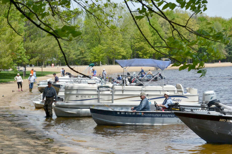 Pike anglers storm the beach at weigh-in time during the Northern Pike Sanford Lake Open in this file photo.