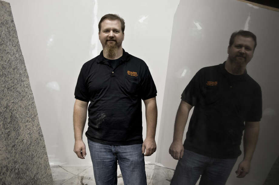 SEAN PROCTOR   sproctor@mdn.netJason Treichel, of Burton, is the owner of Stone Specialists, located on East Pine Street in Midland. This is the company's second location and features an indoor warehouse, allowing the customer to see the entire slab of granite or marble before purchasing. Photo: Sean Proctor/Midland  Daily News