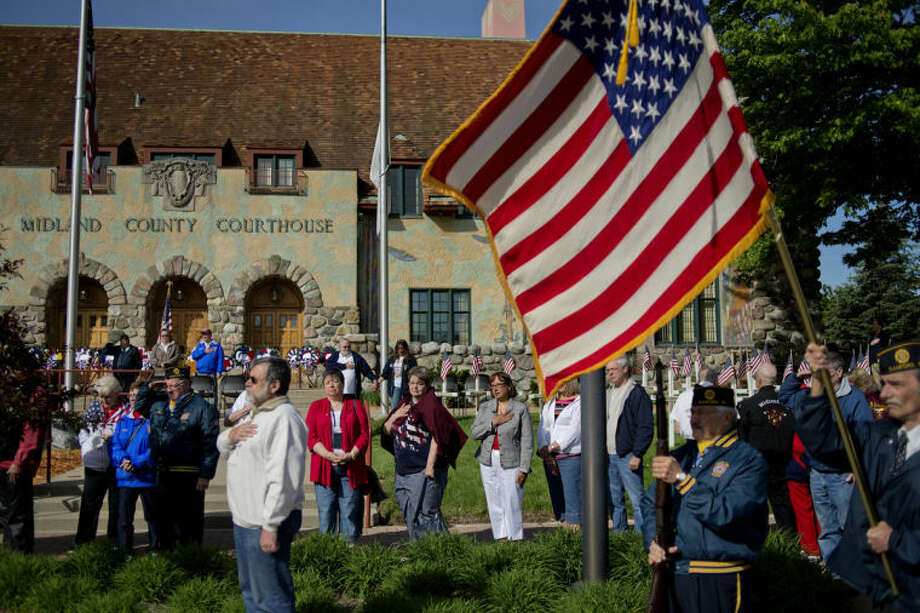 "NICK KING | nking@mdn.netParticipants sing ""God Bless America"" outside the front of the Midland County Courthouse during a Memorial Day ceremony on Monday in Midland. Photo: Nick King/Midland  Daily News"