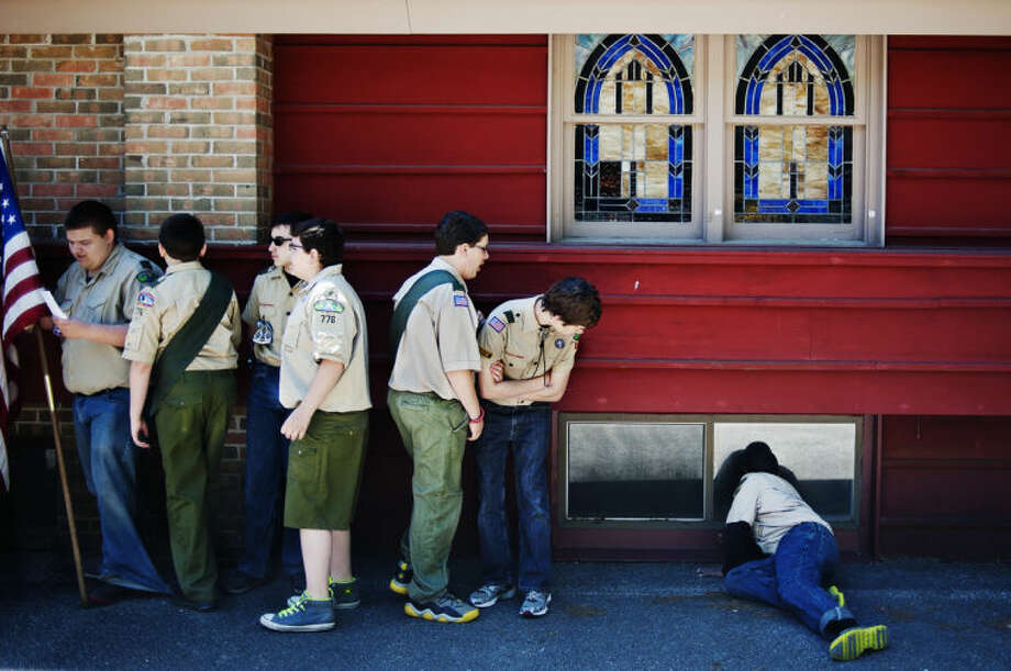 Boys from Troop 776 in Sanford wait to get into formation at the Sanford Memorial Day parade in this Daily News file photo.