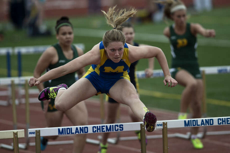 SEAN PROCTOR | sproctor@mdn.netMidland's Rebekah Walter competes in the 100 meter hurdles Tuesday afternoon during the track meet against Dow and Mount Pleasant at Midland High School. Photo: Sean Proctor/Midland  Daily News