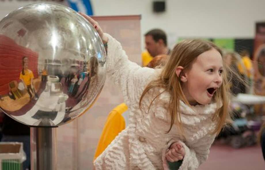 Photo providedTouching a Van de Graaff generator literally makes your hair stand on end.