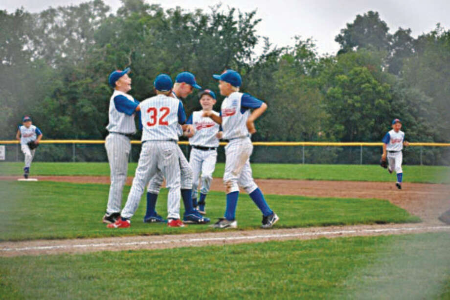 Photo providedPitcher Jacob Stone, center, is congratulated by teammates after the game. Others pictured, from left, are Carter Knochel, Solomon Thomas, Jacob Stone, Maxx Fisher, and Matthew Babinski.