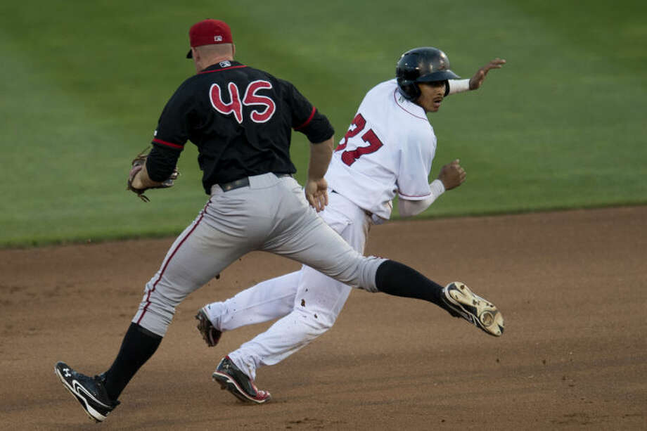 NEIL BLAKE | nblake@mdn.netLoons player James Baldwin is tagged out by Lugnuts first baseman Kevin Patterson during the game at Dow Diamond on Wednesday. Photo: Neil Blake/Midland  Daily News