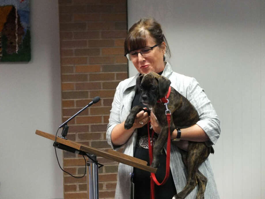 Photo providedJudge Dorene Allen cuddles Dory, the Juvenile Care Center's new therapy dog.