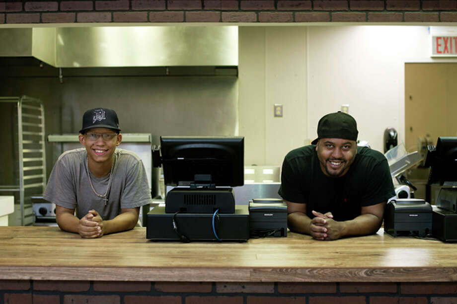 Chip-n-Wich part owners Craig Jones, left, and Jonathan Neely are opening up the restaurant today. The restaurant won Food Network's Food Court Wars. Jones, a Pennsylvania native, and Neely, a Detroit native, serve various flavors of potato chips on all their sandwiches. Photo: Neil Blake/Midland Daily News / Midland Daily News
