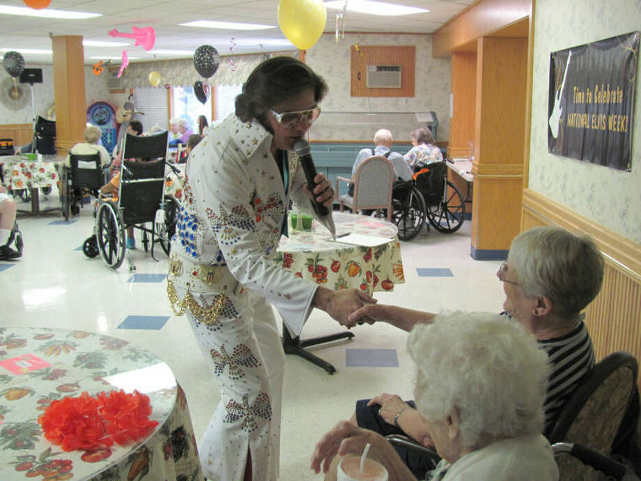 Sam Easter | for the Daily NewsBobby Jacob Greif, a part-time Elvis impersonator and independent contractor from Saginaw, greets residents at Brittany Manor in Midland.