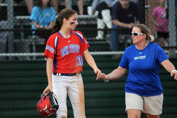 Oak Ridge catcher Amanda Cunniff, left, is a key part in head coach Amanda Brimberry planning as Oak Ridge continues in the playoffs.
