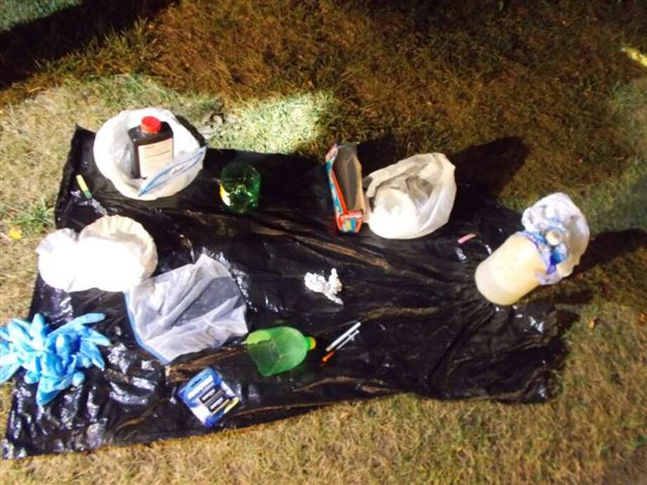 Photo from Midland County Sheriff's Office. Items confiscated from the mobile meth lab.
