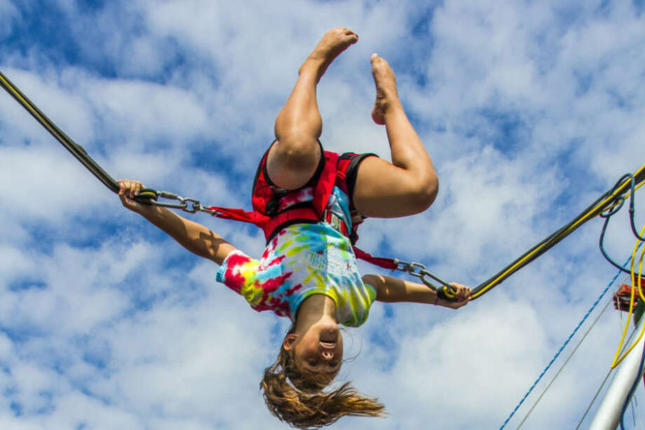 Photo by Zachary Hampel, SpringHill's photographer for the weekA camper enjoys the bungee trampoline during the SpringHill Day Camp at Midland Evangelical Free Church.