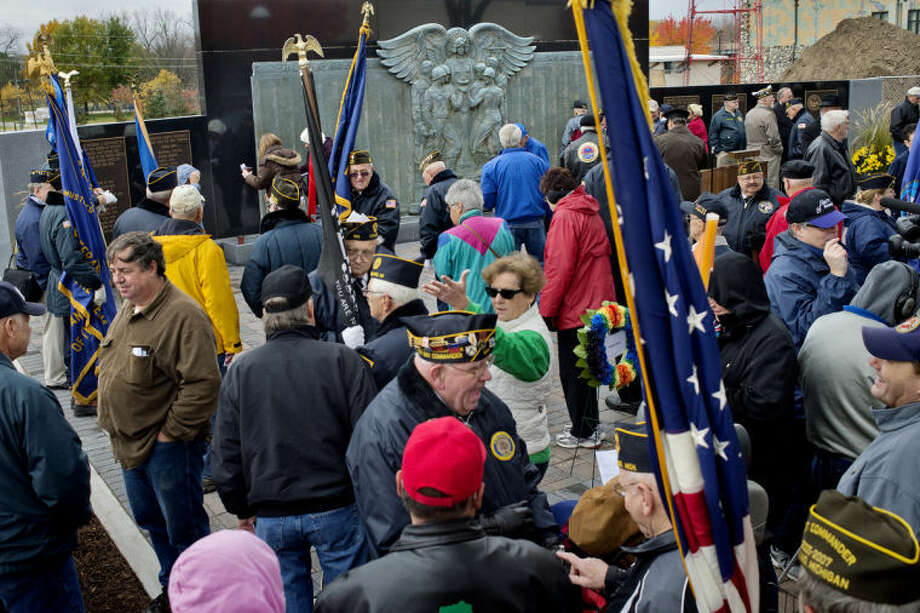NICK KING | nking@mdn.netPeople gather in downtown Midland before the start of a dedication for the newly refurbished and expanded Midland County Veterans Memorial Friday on Main Street. Photo: Nick King/Midland  Daily News