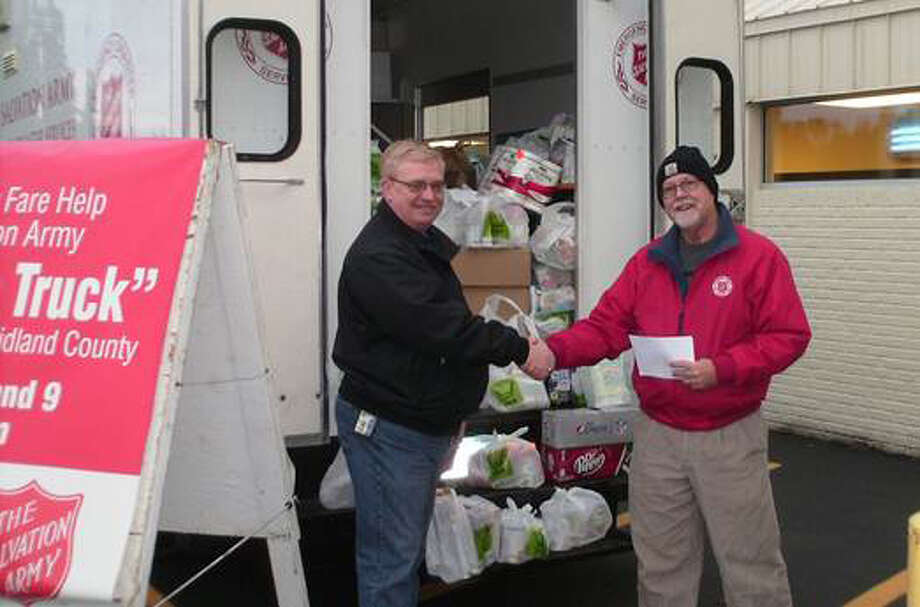 Photo providedPictured, above left, is Paul Conn, store director at Family Fare, and Brent Gilbert, volunteer coordinator at the Salvation Army.