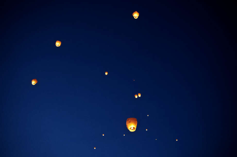 Sky lanterns float into the night sky in this Daily News file photo. The Beaverton City Council recently adopted an ordinance to ban the sky lanterns, along with banning and limiting the use of consumer fireworks.