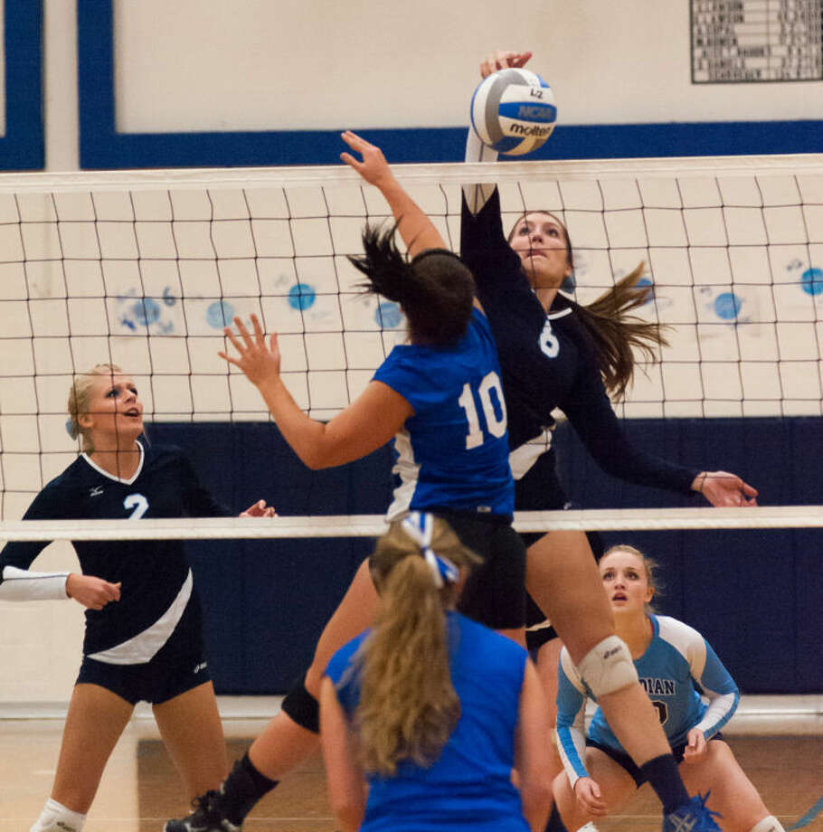 STEVEN SIMPKINS | Daily NewsBlake Garner (8) and Hailey Stockford (2) of Meridian and Jenna Theisen (10) of Beal City battle in the District Class C Tournament Monday.