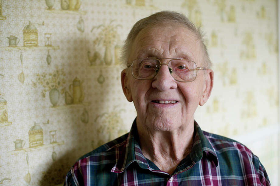 Melvin Swinson of Midland is 95 and still enjoys getting outside to work in his orchard when he can. He keeps busy with numerous hobbies and projects. Photo: Neil Blake/Midland  Daily News / Midland Daily News