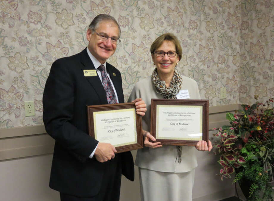 Photo providedMidland Mayor Maureen Donker, right, and Alan Brown pose with framed Community for a Lifetime certificates.