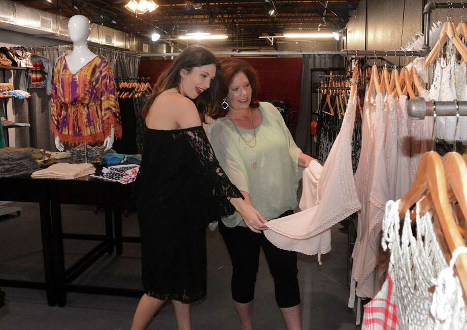 Co-owners Britt Heald and her daughter, Madison, admire a new top in Vickie B's Boutique. In October, the mother-daughter team opened the boutique at 213 West Main St., a block from the depot in Tomball. Photo: David Hopper, Freelance / freelance