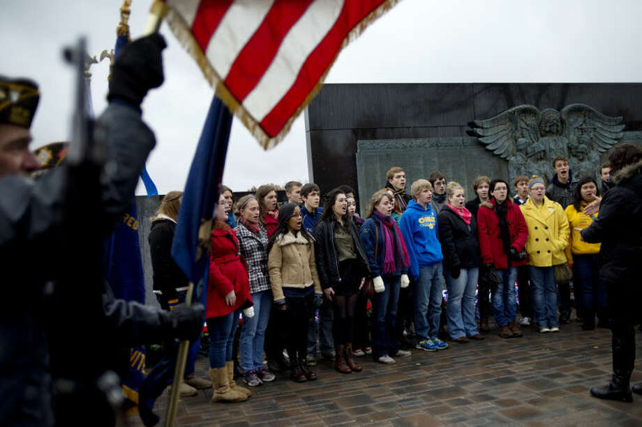 NICK KING | nking@mdn.netStudents from the Midland High School perform the national anthem during a Veterans Day ceremony today at the Midland County Veterans Memorial in downtown Midland. Photo: Nick King/Midland  Daily News