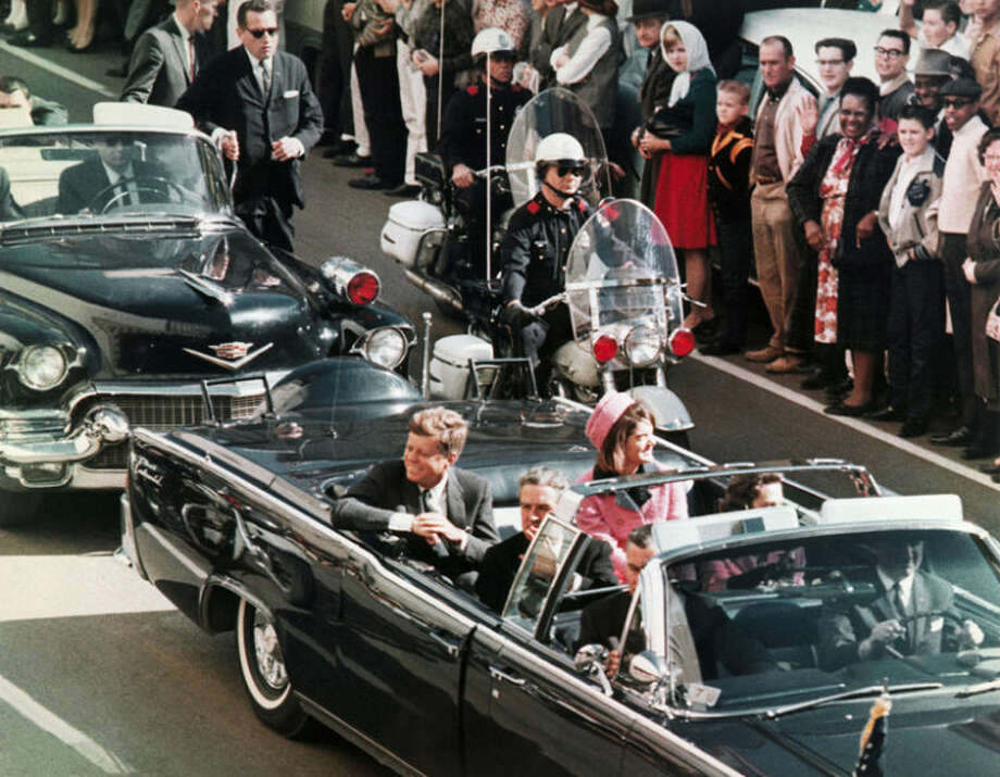 In this Nov. 22, 1963 file photo, President John F. Kennedy's motorcade travels through Dallas shortly before the president was assassinated. Photo: Uncredited