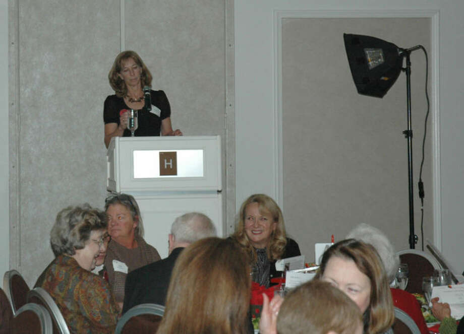 Photo by Doug FowlerKathy Hansen, honorary chair, speaks at the Dine on the Doors fundraiser for Midland's Open Door. The event took place Tuesday at the H Hotel and drew 250 guests.