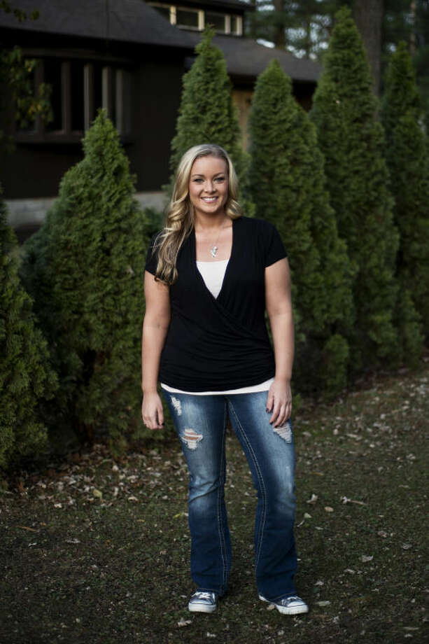 Myndy Sasse, 31, lost 110 pounds over the past three years and recently won $1,000 for her Atkins success story. Photo: Sean Proctor/Midland  Daily News