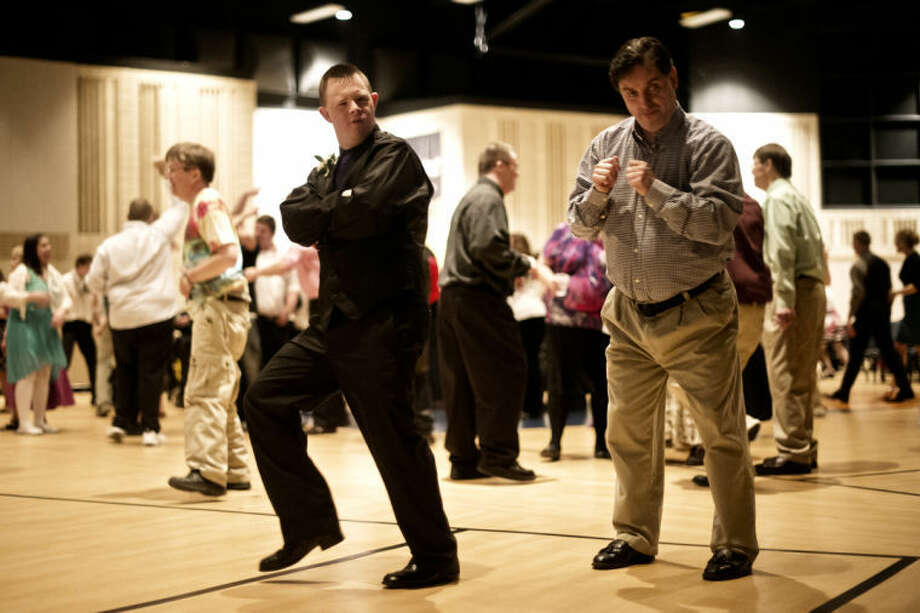 "SEAN PROCTOR | sproctor@mdn.netGlen Soleberg, left, and Rick Blevens, both of Midland, dance to the music during the ""A Night to Remember"" dinner and dance at the Midland Evangelical Free Church. Photo: Sean Proctor"