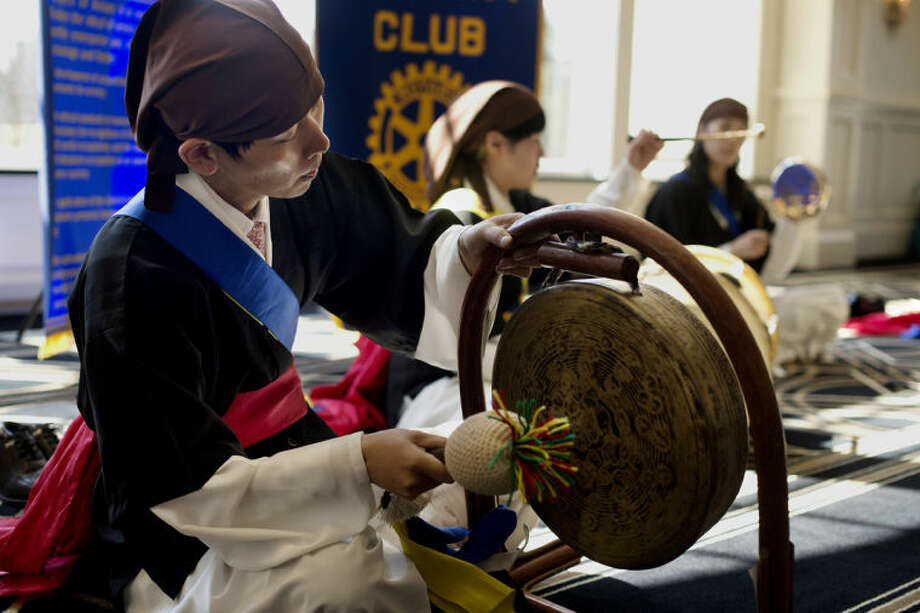 NEIL BLAKE | nblake@mdn.netMin-Kyu Kang of South Korea takes part in a musical presentation during a visit to the Midland Noon Rotary Club at the Midland Country Club on Thursday. Min-Kyu Kang is part of a group from Daejeon, South Korea, on a visit to parts of Michigan.