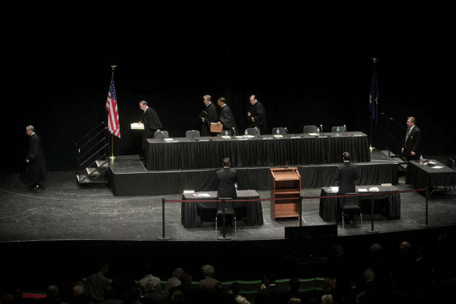 SEAN PROCTOR | sproctor@mdn.netMichigan Supreme Court Justices leave the stage after hearing oral arguments for about an hour in front of an audience of Midland County high school students on Wednesday at the Midland Center for the Arts. Photo: Nick King/Midland  Daily News