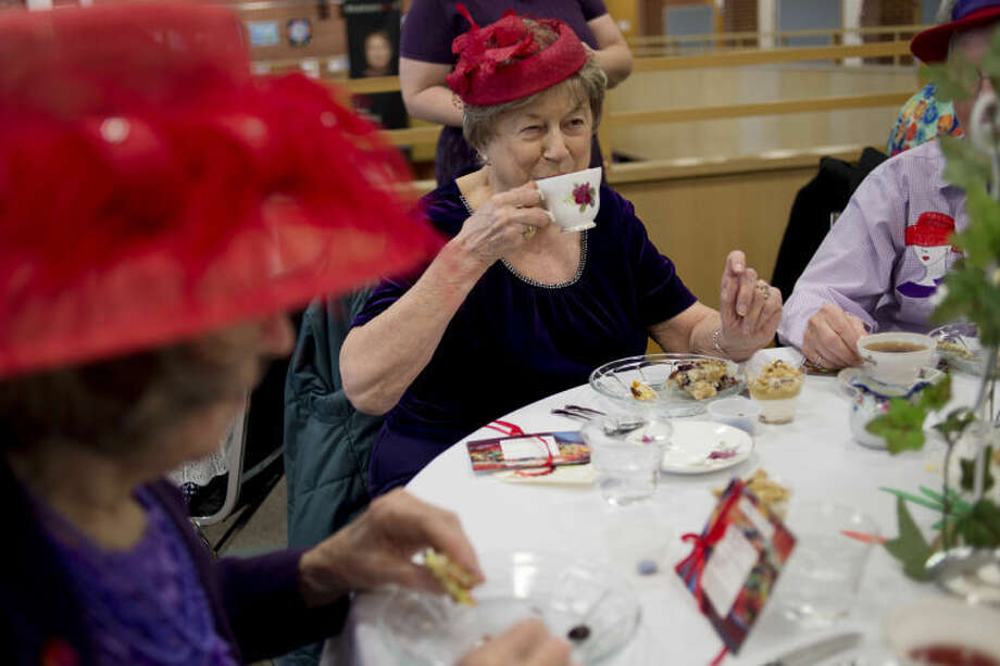 NICK KING | nking@mdn.netRoz Roberts, center, enjoys a cup of tea with her friends during the Grace A. Dow Memorial Library Annual Tea. Photo: Nick King/Midland  Daily News