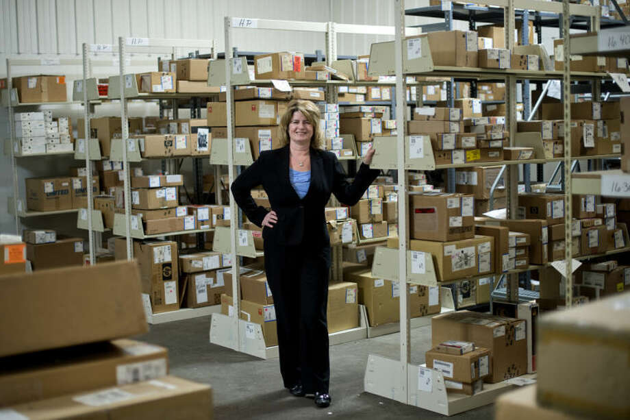 NICK KING | nking@mdn.netCandace Larkin, owner of EZ Pro Delivery, poses in the new Midland warehouse. Photo: Nick King/Midland  Daily News