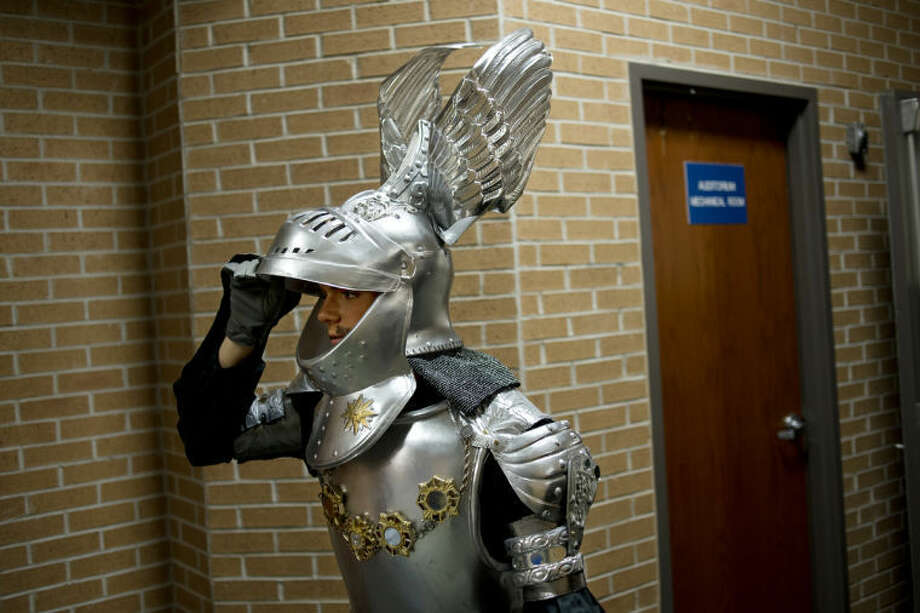 "NEIL BLAKE | nblake@mdn.netMidland High School senior Jordan Poland prepares to go on stage as the ""Knight of Mirrors"" in a showdown with Don Quixote during a dress rehearsal of ""Man of La Mancha"" at Central Middle School on Monday. Photo: Neil Blake/Midland  Daily News"