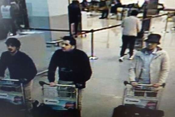 """A picture released on March 22, 2016 by the belgian federal police on demand of the Federal prosecutor shows a screengrab of the airport CCTV camera showing three suspects of this morning's attacks at Brussels Airport, in Zaventem.   Two explosions in the departure hall of Brussels Airport this morning took the lives of 14 people, 81 got injured. Government sources speak of a terrorist attack. The terrorist threat level has been heightened to four across the country. / AFP PHOTO / BELGIAN FEDERAL POLICE / - / RESTRICTED TO EDITORIAL USE - MANDATORY CREDIT """"AFP PHOTO / BELGIAN FEDERAL POLICE"""" - NO MARKETING NO ADVERTISING CAMPAIGNS - DISTRIBUTED AS A SERVICE TO CLIENTS  -/AFP/Getty Images"""