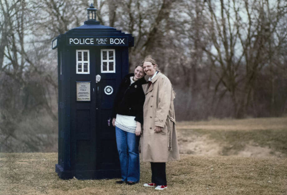 Courtesy PhotoNick D. Clements proposed to Lisa Bissonnette at the Tridge next to a full-size Tardis, a replica of the London police box that Dr. Who uses to travel in time. Photo: Neil Blake/Midland  Daily News