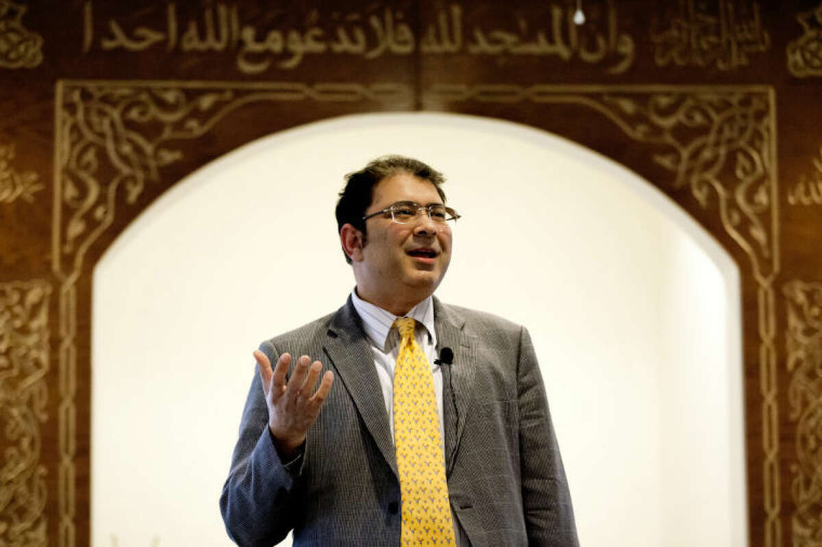"""JEFFREY SMITH   for the Daily NewsSarosh Anwar, a Saginaw resident and president of the Saginaw Islamic Center, speaks during the """"Choosing a Culture of Understanding"""" event Friday evening at the Islamic Center of Midland."""