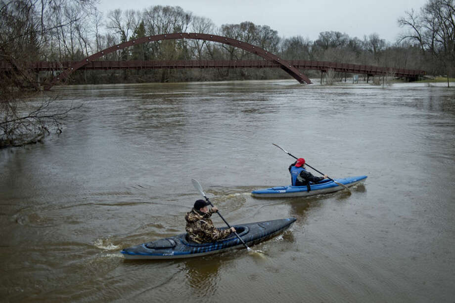 Kayakers head out on the Tittabawassee River in this Daily News file photo. The Tittabawassee is forecasted to crest at 22.3 feet Saturday, which would cause some minor flooding in the Midland area.