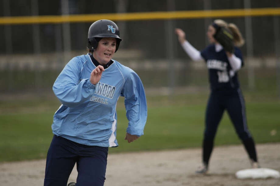 NEIL BLAKE | nblake@mdn.netNorthwood's Stacey Klonowski rounds third base during first game against Hillsdale at Northwood University on Wednesday. Photo: Neil Blake/Midland  Daily News