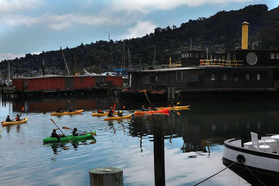Kayakers pass by the ferryboat Vallejo (with yellow stack on right) in Sausalito, California, on Thursday, September 12, 2013.  The boat was the epicenter of the houseboat counterculture during the sixties and seventies and was shared by eccentric artist Jean Varda and Zen philosopher Alan Watts. Photo: Liz Hafalia, The Chronicle