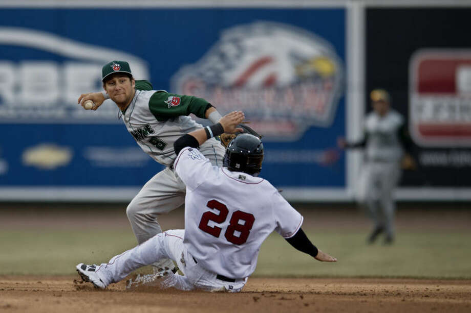 SEAN PROCTOR | sproctor@mdn.netThe Loons' Tyler Ogle slides into second as the TinCaps Maxx Tissenbaum tries to turn a double play during opening day at Dow Diamond. The Loons fell to the TinCaps 5-2. Photo: Sean Proctor/Midland  Daily News