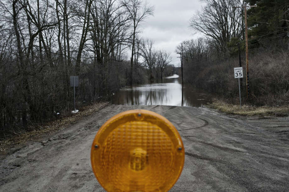 SEAN PROCTOR | sproctor@mdn.net North Tittabawassee River Road at the entrance of Northwood University after heavy rainfall and flooding on Wednesday. Photo: Nick King/Midland  Daily News