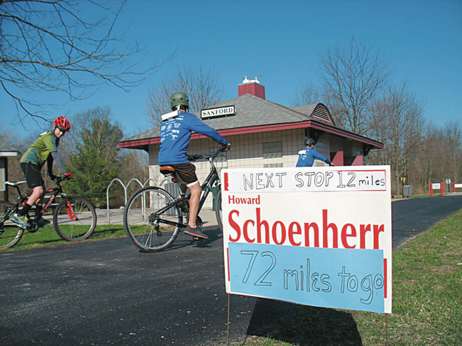 "Cyclists leave the Sanford rest stop Saturday morning during the inaugural Howard's Friend Bike Ride in memory of Howard ""Putter"" Schoenherr. More than 200 people who registered for the ride, which began at Midland's Farmers Market, could choose distances up to 80 miles. Proceeds are to benefit the Pere Marquette Rail-Trail, on which the ride was held. Schoenherr was a Midland County commissioner and avid cyclist. He died Sept. 17, 2012 — three months before his 80th birthday, on which he hoped to ride 80 miles. The ride Saturday was for all ages and skill levels, and organizers hope to make it an annual event. The ride's website is www.howardsfriendbikeride.com"