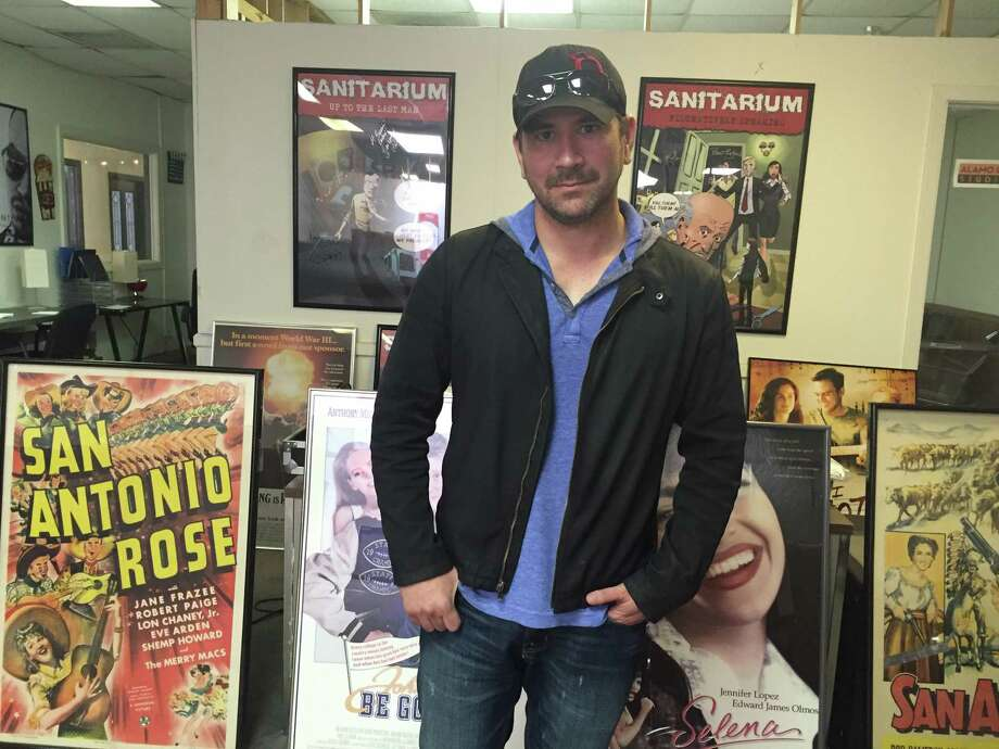 Prominent San Antonio filmmaker Kerry Valderrama is surrounded by posters of movies and TV shows that were filmed in San Antonio, including his own horror film, 'Sanitarium.' Photo: Courtesy Jeanne Jakle