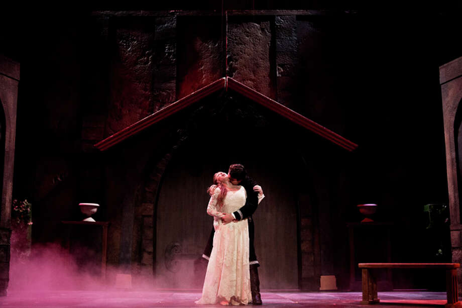 SEAN PROCTOR | sproctor@mdn.net Tony Serra, playing the role of Dracula, and Calyn Liberati, playing the role of Lucy, perform a scene Tuesday during dress rehearsal for Dracula in the Little Theater at the Midland Center for the Arts. The play opens Friday at 8 p.m. and will perform eight shows over three weekends, closing on Oct. 12. Photo: Sean Proctor/Midland  Daily News / Midland Daily News