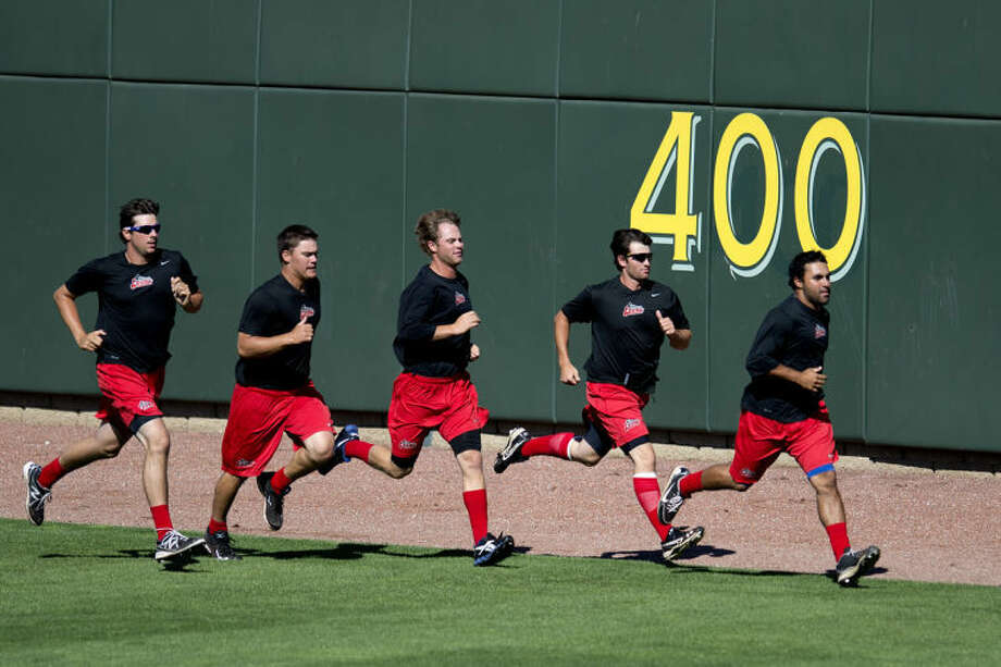 NICK KING | nking@mdn.netGreat Lakes Loons players run around the outfield during practice Tuesday at Dow Diamond. Photo: Nick King/Midland  Daily News