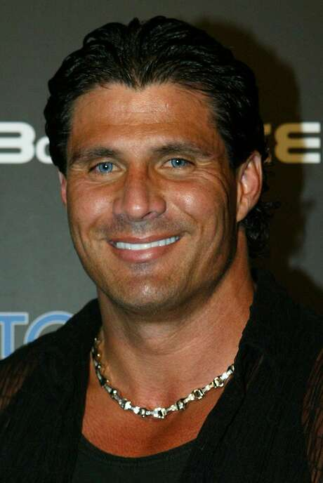 **FILE** Retired baseball player Jose Canseco arrives for the BoSPOKER.com $100,000 Celebrity Poker Tournament 2004 in Beverly Hills, Calif, in an Oct. 8, 2004 photo. In his upcoming book, Jose Canseco said he introduced Rafael Palmeiro, Ivan Rodriguez and Juan Gonzalez to steroids after being traded to Texas in 1992, the New York Daily News reported. Canseco said Bush, the Rangers' managing partner at the time, must have known about the drugs. President Bush was not aware of any steroid use by Texas Rangers players while he was a team executive, the White House said Monday, Feb. 7, 2005. (AP Photo/Danny Moloshok, File) Photo: DANNY MOLOSHOK, AP
