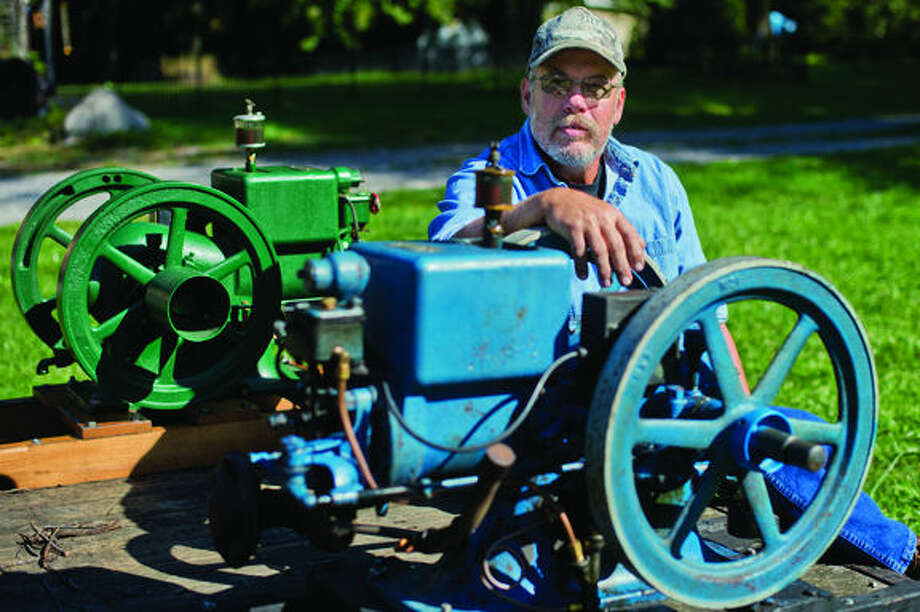 Dale Thompson, of Midland, found and restored several engines owned by his brothers, all originally purchased by his father. The engines in the foreground and background are 1926 McCormick-Deering machines. The one in front belonged to Dale's father. The engines are small power sources that run on gas and were used back in the day to power water pumps, or bring electricity to a house or farm. Photo: Nick King/Midland  Daily News