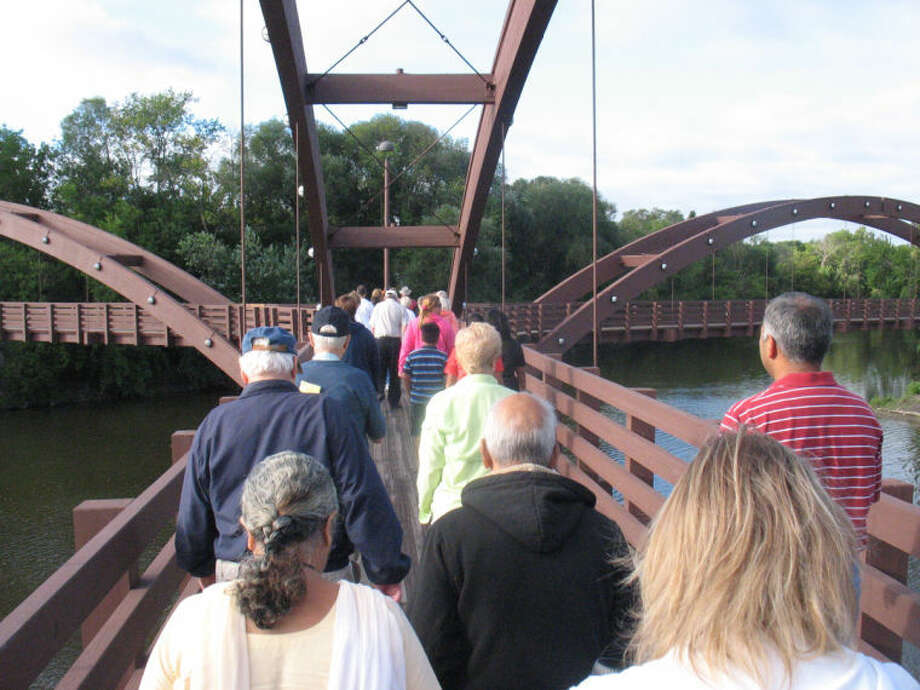 STUART FROHM | for the Daily NewsMidland's Labor Day Tridge Walk proceeds after no band or official leader appeared for the event, which was launched in 1992. About 50 people made the brief walk Monday. Hundreds have gathered in past years.