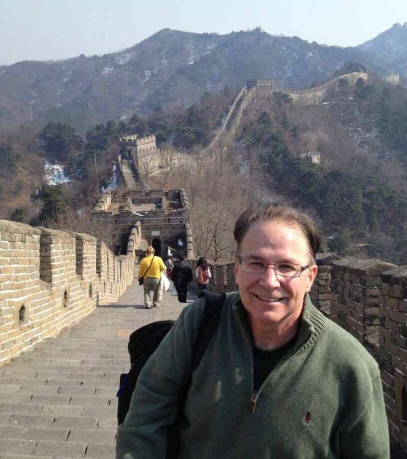 Photo providedThe author Tom Watkins at the Great Wall in China.